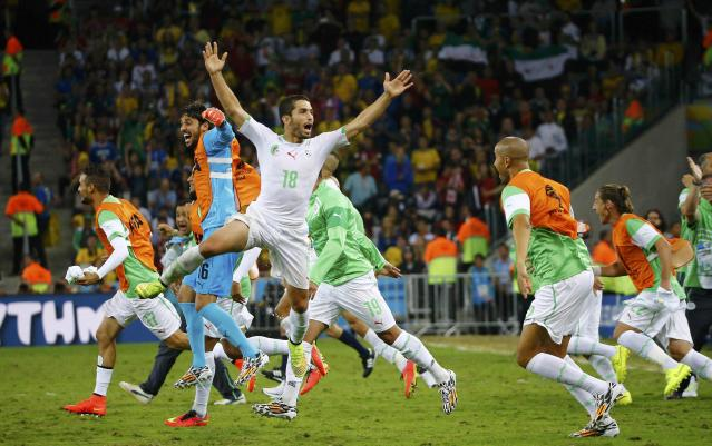 Algeria's Abdelmoumene Djabou (C) celebrates with his teammates at the end of their 2014 World Cup Group H soccer match against Russia at the Baixada arena in Curitiba June 26, 2014. REUTERS/Murad Sezer (BRAZIL - Tags: SOCCER SPORT WORLD CUP TPX IMAGES OF THE DAY TOPCUP)