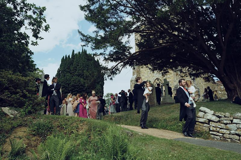 Worse-for-wear flower girls and page boys getting a helping hand down the church path