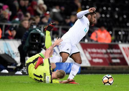 Soccer Football - FA Cup Fourth Round Replay - Swansea City vs Notts County - Liberty Stadium, Swansea, Britain - February 6, 2018 Notts County's Terry Hawkridge in action with Swansea City's Wayne Routledge REUTERS/Rebecca Naden