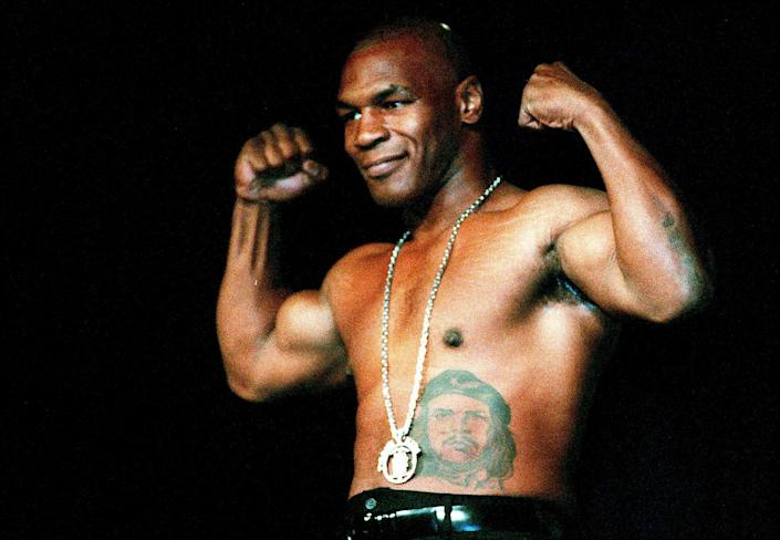Mike Tyson pictured flexing his muscles in 2000 (Getty)