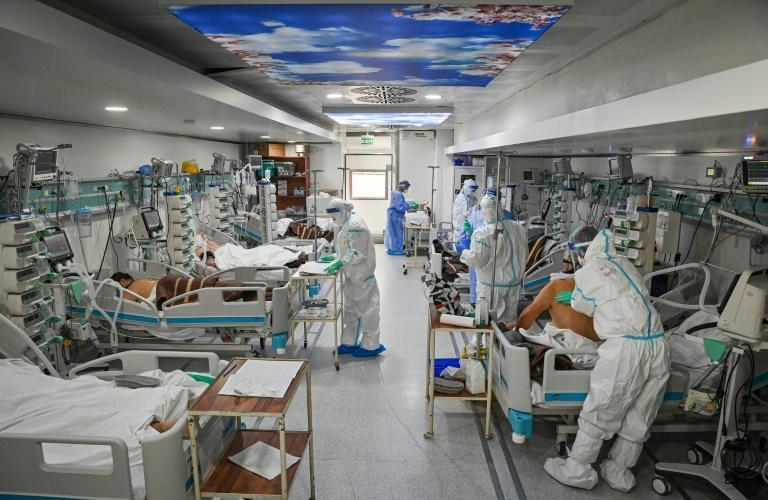 With even higher infection rates expected later this month, hospitals have been asked to suspend any 'non urgent' operations and hospital stays (AFP/Daniel MIHAILESCU)