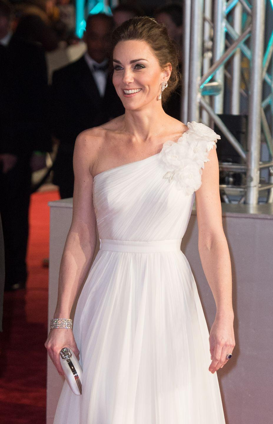 <p>Duchess Kate attended the BAFTAs this year in a flowing white gown paired with a romantic updo and a pair of Princess Diana's earrings. </p>
