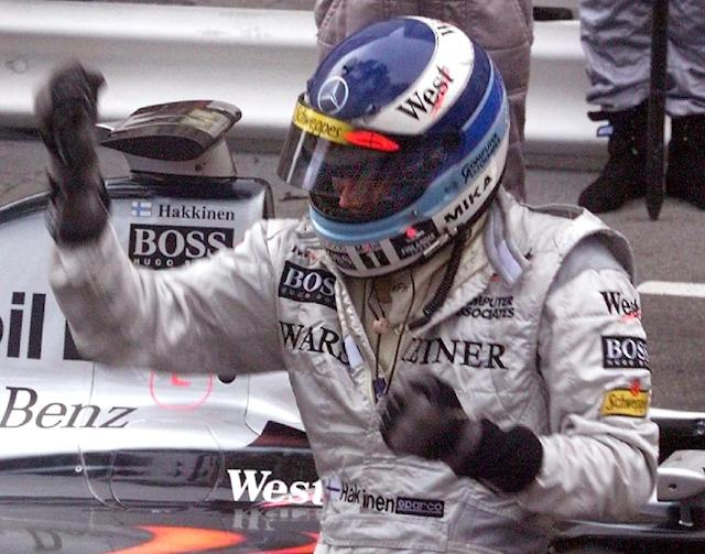 Mika Hakkinen wore a distinctive blue and white helmet when he won the Monaco Grand Prix 20 years ago Finnish McLaren-Mercedes driver Mika Hakkinen dances in victory, 24 May, after winning the 56th Monaco Formula one Grand prix. Italian Giancarlo Fisichella placed second, Irish Eddie Irvine is third. (ELECTRONIC IMAGE). (AFP Photo/ERIC CABANIS)