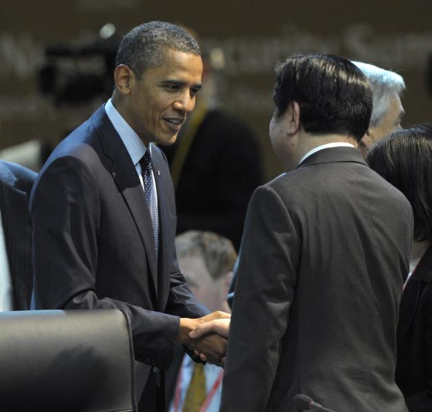 U.S. President Barack Obama talks with Japanese Prime Minister Yoshihiko Noda before the start of the plenary session of the Nuclear Security Summit at the Coex Center in Seoul, South Korea, Tuesday, March 27, 2012. (AP Photo/Susan Walsh)