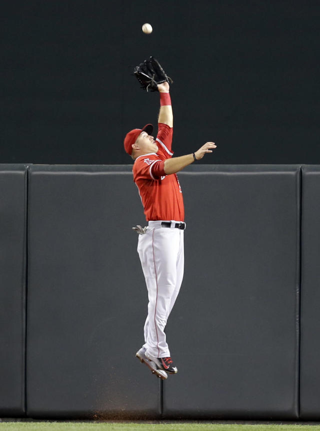 Los Angeles Angels center fielder Mike Trout makes a leaping catch on a fly ball by Baltimore Orioles' Nick Markakis in the fifth inning of a baseball game, Wednesday, July 30, 2014, in Baltimore. Baltimore won 4-3. (AP Photo/Patrick Semansky)