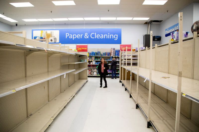FILE PHOTO: People gather supplies at a grocery store amid coronavirus fears spreading in Toronto