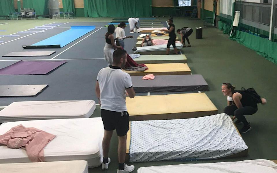 Beds are laid out in the Westway Sports Centre - Credit: Jack Hardy/PA
