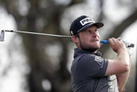 Tyrell Hatton, of England, watches his shot from the seventh tee during the second round of the Arnold Palmer Invitational golf tournament Friday, March 6, 2020, in Orlando, Fla. (AP Photo/John Raoux)