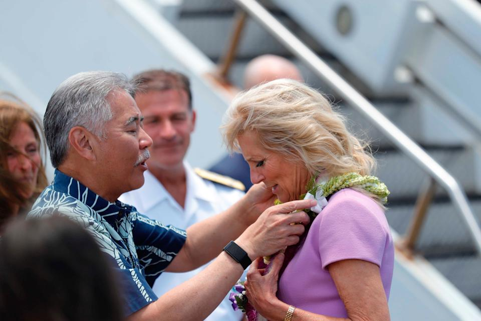First Lady Jill Biden is heading to the Walter Reed military hospital for a procedure, after getting an object lodged in her foot last weekend on a beach during a series of official events in Hawaii. ((Jamm Aquino/Honolulu Star-Advertiser via AP))