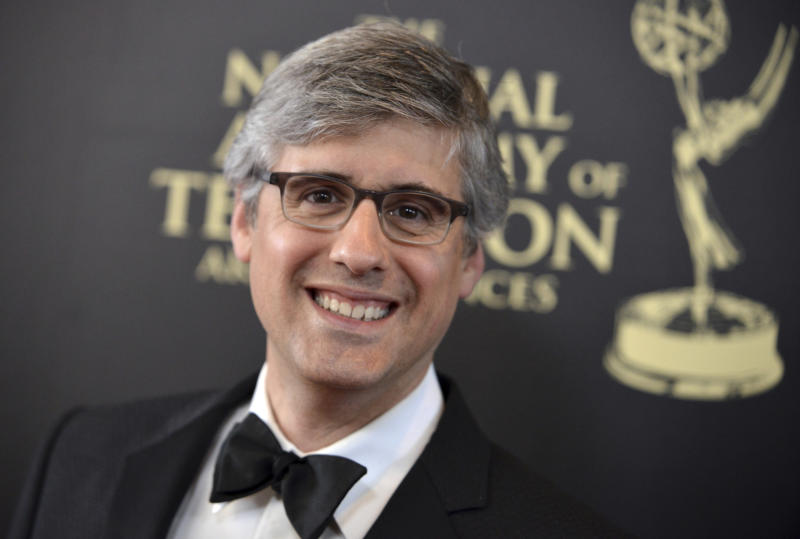 """FILE - This June 22, 2014 file photo shows Mo Rocca at the 41st annual Daytime Emmy Awards in Beverly Hills, Calif. Rocca released a book """"Mobituaries: Great Lives Worth Reliving, """" in November. (Photo by Richard Shotwell/Invision/AP, File)"""