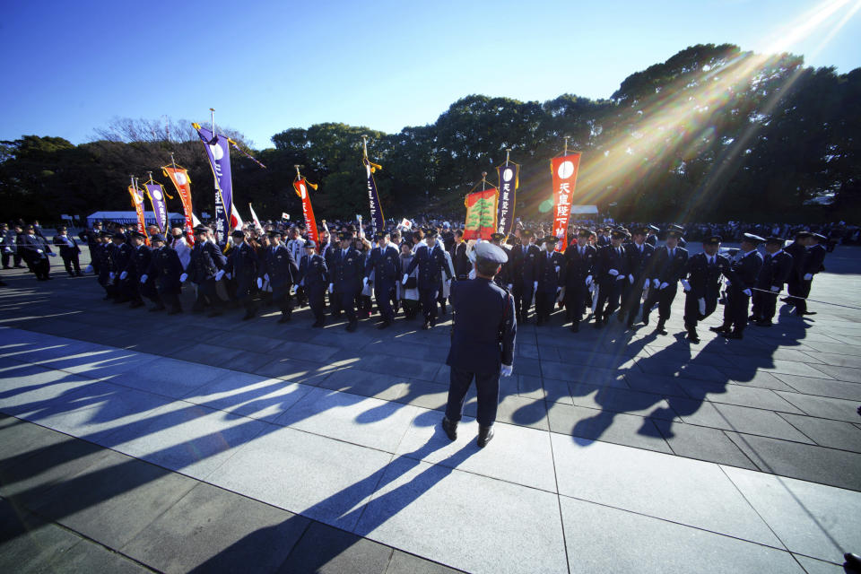 Well-wishers walk toward the venue for Japan's Emperor Akihito's public appearance with his family members at Imperial Palace in Tokyo Wednesday, Jan. 2, 2019. (AP Photo/Eugene Hoshiko)