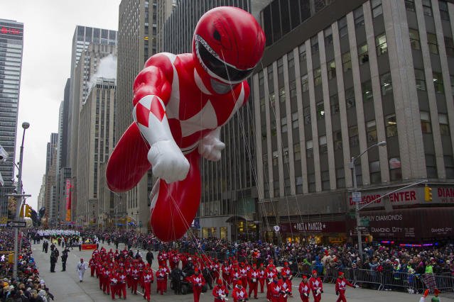 <p>Red Ranger Morphin Power Ranger balloon is brought down 6th Ave. in the 88th Macy's Thanksgiving Day Parade in New York in New York, Nov. 27, 2014. (Photo: Gordon Donovan/Yahoo News) </p>