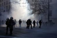 Riot police advance amid tear gas as they clash with Greek university students during a demonstration against government plans to set up university police, amid the coronavirus disease (COVID-19) pandemic, in Athens