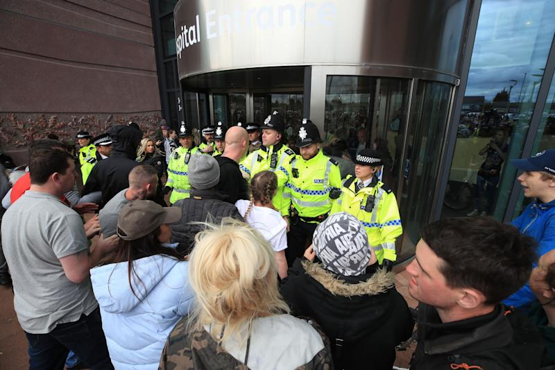 Police block protesters from the entrance to Alder Hey Children's Hospital in Liverpool (Picture: PA)