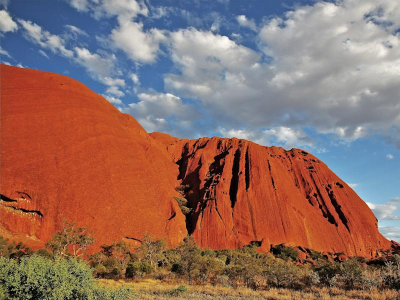 Uluru, formerly Ayers Rock, used to be visited by over 250,000 people each year (Getty Images)