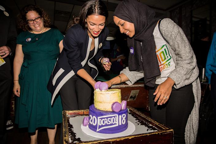 Campaign manager Vigie Ramos Rios, left, with Alexandria Ocasio-Cortez, center. (Photo: Scott Heins/Getty Images)