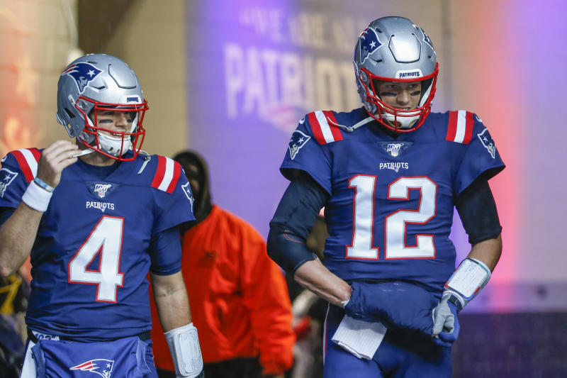 Oct 27, 2019; Foxborough, MA, USA; New England Patriots quarterback Jarrett Stidham (4) and quarterback Tom Brady (12) take the field before the game at Gillette Stadium. Mandatory Credit: Greg M. Cooper-USA TODAY Sports