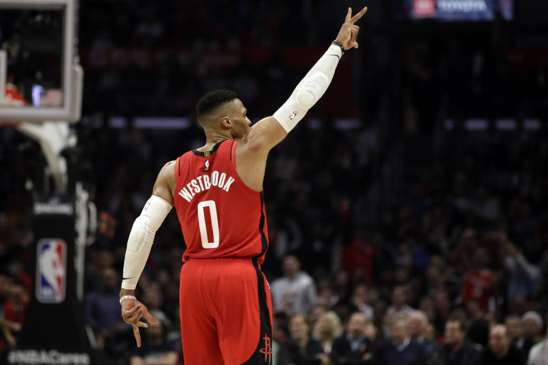 Houston Rockets' Russell Westbrook (0) celebrates after scoring against the Los Angeles Clippers during the second half of an NBA basketball game Thursday, Dec. 19, 2019, in Los Angeles. (AP Photo/Marcio Jose Sanchez)