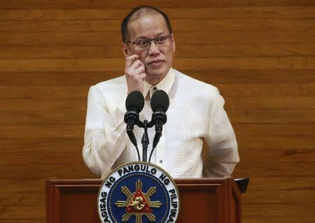 Philippine President Benigno Aquino gestures while delivering his last State of the Nation Address (SONA) during the joint session of the 16th Congress at the House of Representatives in Quezon city, metro Manila July 27, 2015. REUTERS/Romeo Ranoco