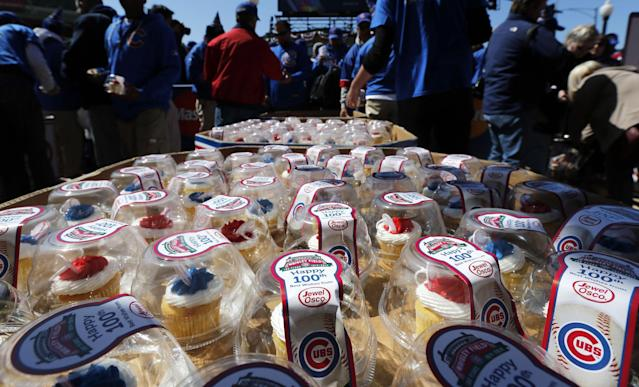Cup cakes wait for baseball fans as they enter Wrigley Field on the 100th anniversary of the first baseball game at the park, before a game between the Arizona Diamondbacks and Chicago Cubs, Wednesday, April 23, 2014, in Chicago. (AP Photo/Charles Rex Arbogast)