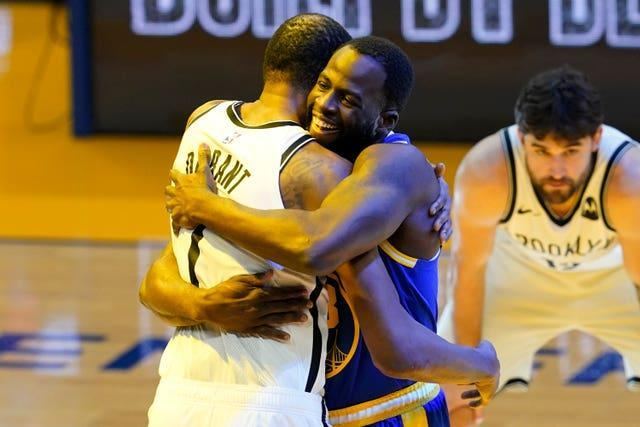 Kevin Durant got a friendly welcome from his former team-mate Draymond Green, before leading his Brooklyn Nets to victory over the Golden State Warriors