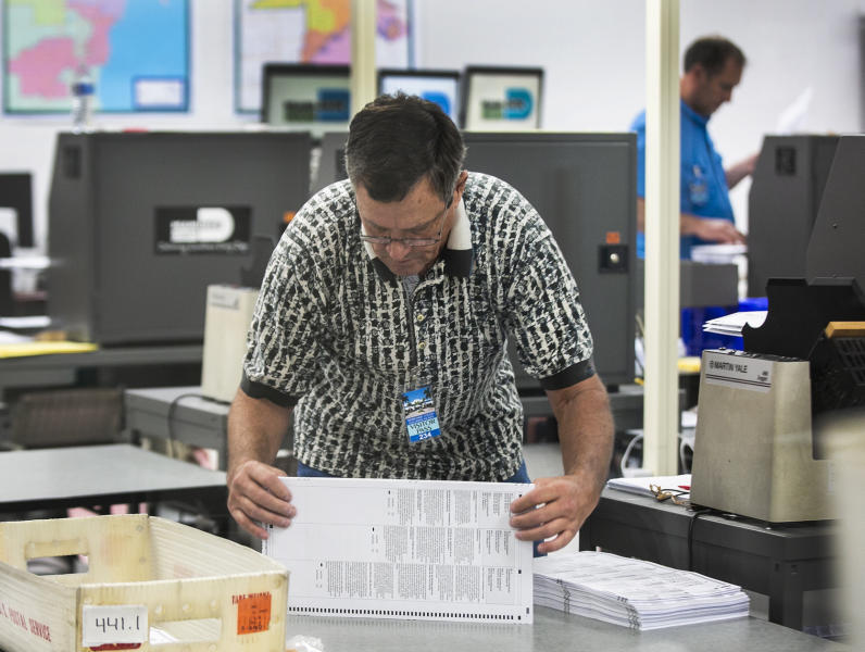 Miami-Dade Election Center supervisors recount the ballots and are already halfway through the recount total on Monday, Nov. 12, 2018. (C.M. Guerrero/Miami Herald via AP)
