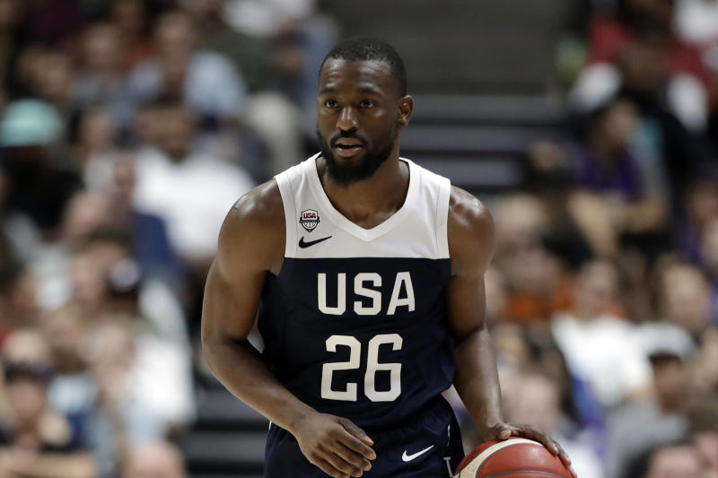 FILE - In this Aug. 16, 2019, file photo, United States' Kemba Walker is shown during the second half of an exhibition basketball game against Spain in Anaheim, Calif. The Boston Celtics will have at least three and possibly four players on the final 12-man roster that USA Basketball will take to China next week for the FIBA World Cup. So these Team USA practices have been a get-to-know-you bonus of sorts for new Celtics guard Kemba Walker and Boston teammates Jayson Tatum, Jaylen Brown and Marcus Smart. (AP Photo/Marcio Jose Sanchez, File)