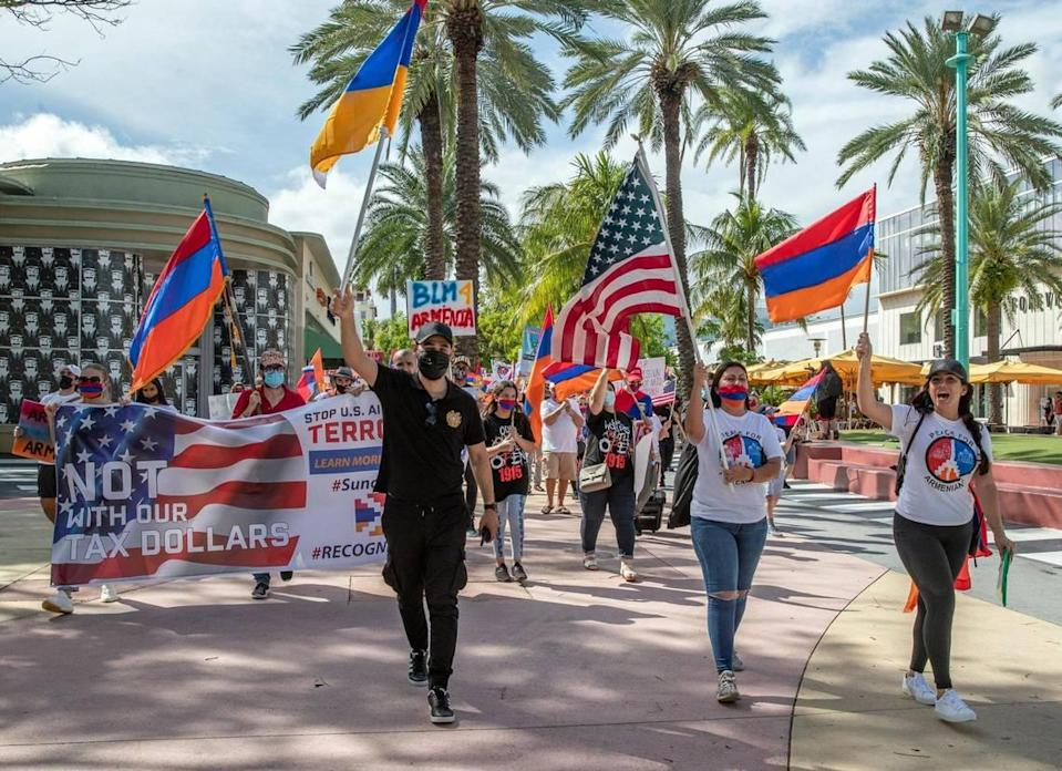 Protesters march along Lincoln Road against the government of Azerbaijan, and in favor of national independence for the Republic of Artsakh on Miami Beach on Friday, October 23, 2020.