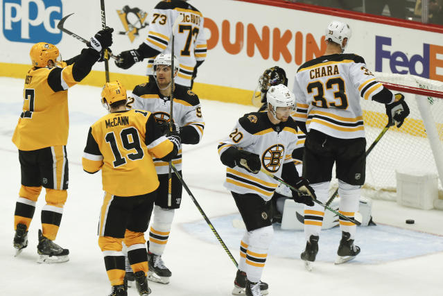 Pittsburgh Penguins' Bryan Rust, left, celebrates after scoring the go-ahead goal against the Boston Bruins during the third period of an NHL hockey game, Sunday, Jan. 19, 2020, in Pittsburgh. (AP Photo/Keith Srakocic)