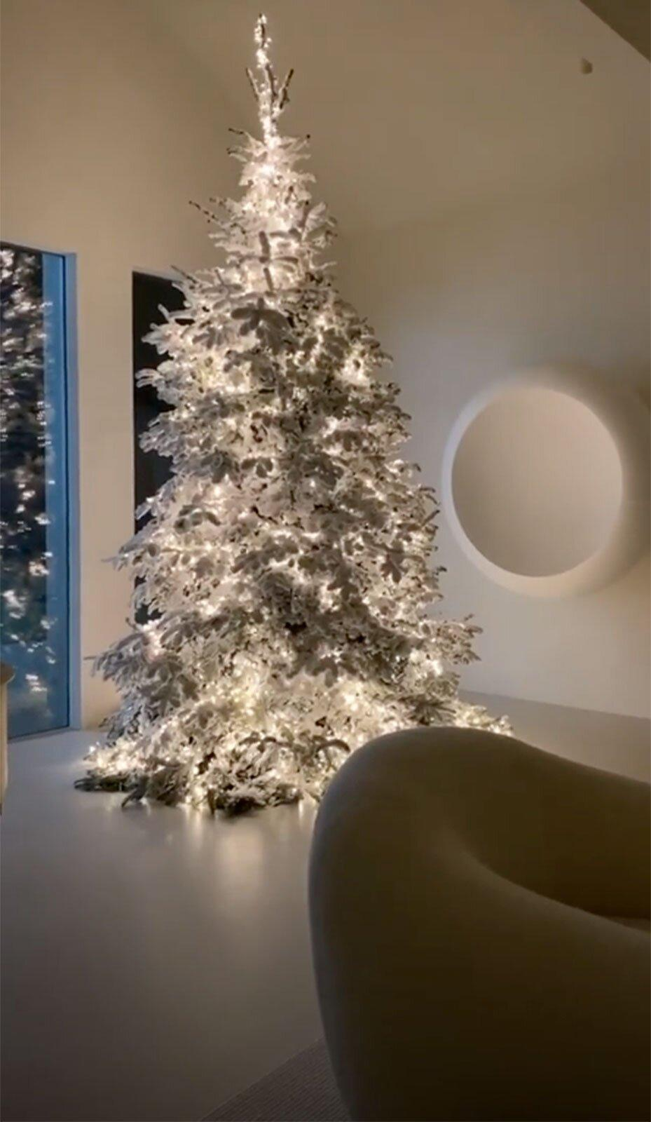 Evergreen is not a shade found in Kim's decor, so her Christmas tree was sprayed white before being strung with white lights.