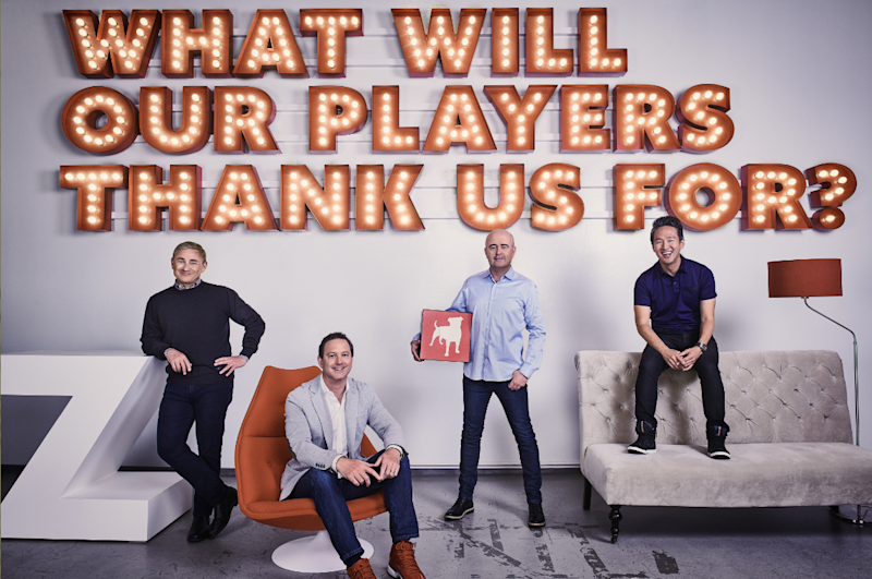 Four Zynga executives in front of a wall reading what will our players thanks us for?