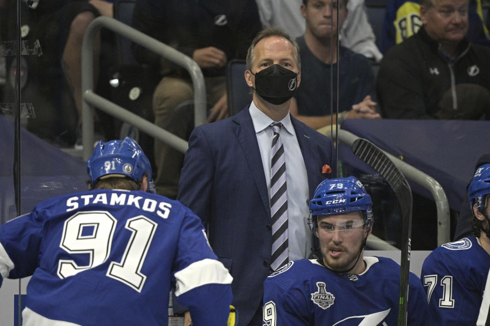 Tampa Bay Lightning head coach Jon Cooper watches from the bench during the second period in Game 1 of the NHL hockey Stanley Cup finals against the Montreal Canadiens, Monday, June 28, 2021, in Tampa, Fla. (AP Photo/Phelan Ebenhack)