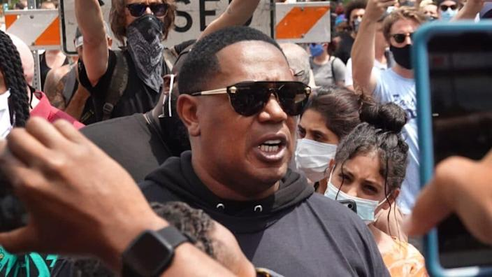 """Percy """"Master P"""" Miller is shown attending last June's memorial service for George Floyd at North Central University in Minneapolis, Minnesota.(Photo by Scott Olson/Getty Images)"""