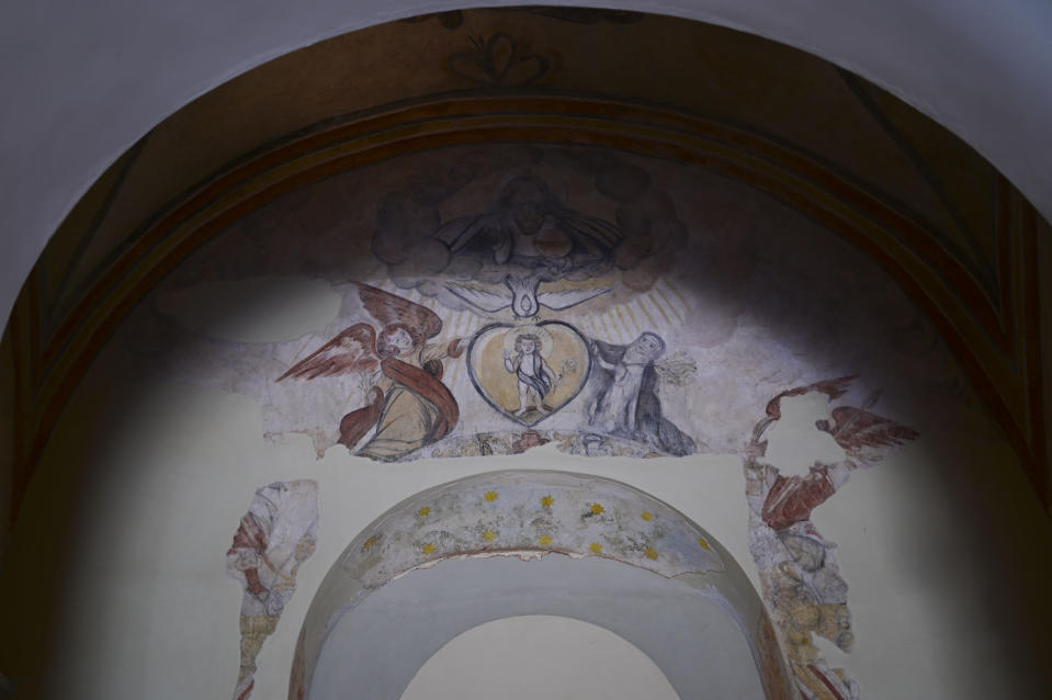 Details of a centuries-old mural are preserved inside San Jose Church, the second oldest Spanish church in the Americas, which will reopen following a massive reconstruction that took nearly two decades to complete, in San Juan, Puerto Rico, Tuesday, March 9, 2021. As workers probed with radar and laser technology and physically peeled away the church's layers, they uncovered centuries-old murals and architectural techniques once used by the Romans. (AP Photo/Carlos Giusti)