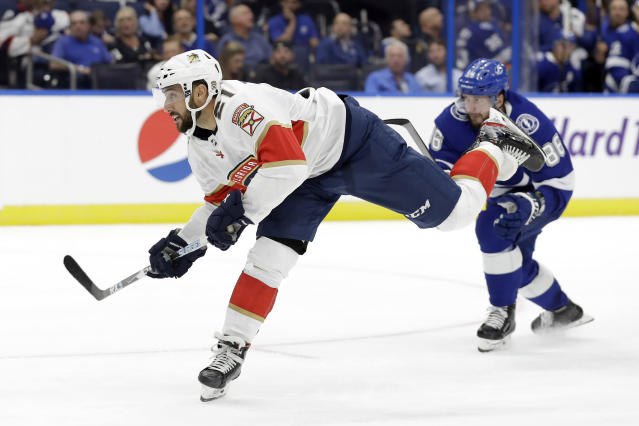 Florida Panthers center Vincent Trocheck (21) watches his shorthanded goal against the Tampa Bay Lightning during the third period of an NHL hockey game Thursday, Oct. 3, 2019, in Tampa, Fla. (AP Photo/Chris O'Meara)