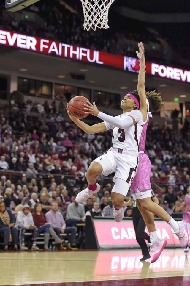South Carolina's Destanni Henderson, front, shoots while defended by LSU's Khayla Pointer during the first half of an NCAA college basketball game Thursday, Feb. 20, 2020, in Columbia, S.C. (AP Photo/Richard Shiro)