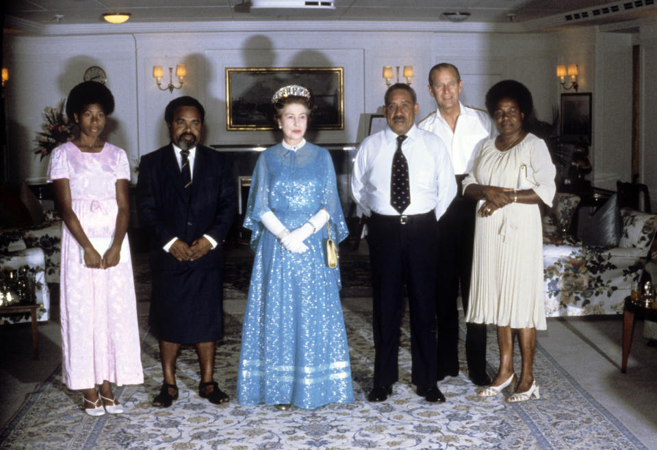PAPUA NEW GUINEA - OCTOBER 14:  Queen Elizabeth ll and Prince Philip, Duke of Edinburgh give a reception on board Britannia on October 14, 1982 in Papua New Guinea.  (Photo by Anwar Hussein/Getty Images)
