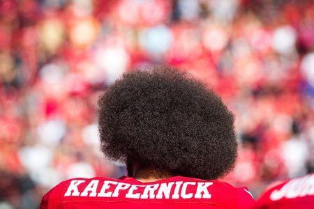 FILE PHOTO: San Francisco 49ers quarterback Colin Kaepernick prepares to take the field before an NFL game against the Tampa Bay Buccaneers at Levi's Stadium in Santa Clara, California, U.S. October 23, 2016. Picture taken October 23, 2016. REUTERS/Loren Elliott