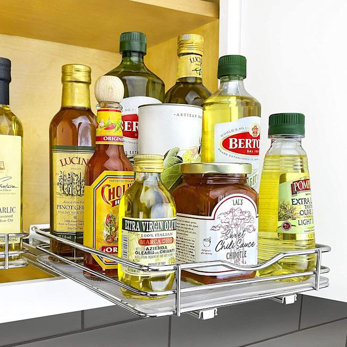 Lynk Professional Slide Out Spice Rack Upper Cabinet Organizer. (Image via Amazon)