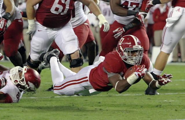 Alabama running back Kenyan Drake (17) dives for the goal line, but comes up short during the first half of an NCAA college football game against Arkansas on Saturday, Oct. 19, 2013, in Tuscaloosa, Ala. (AP Photo/Butch Dill)