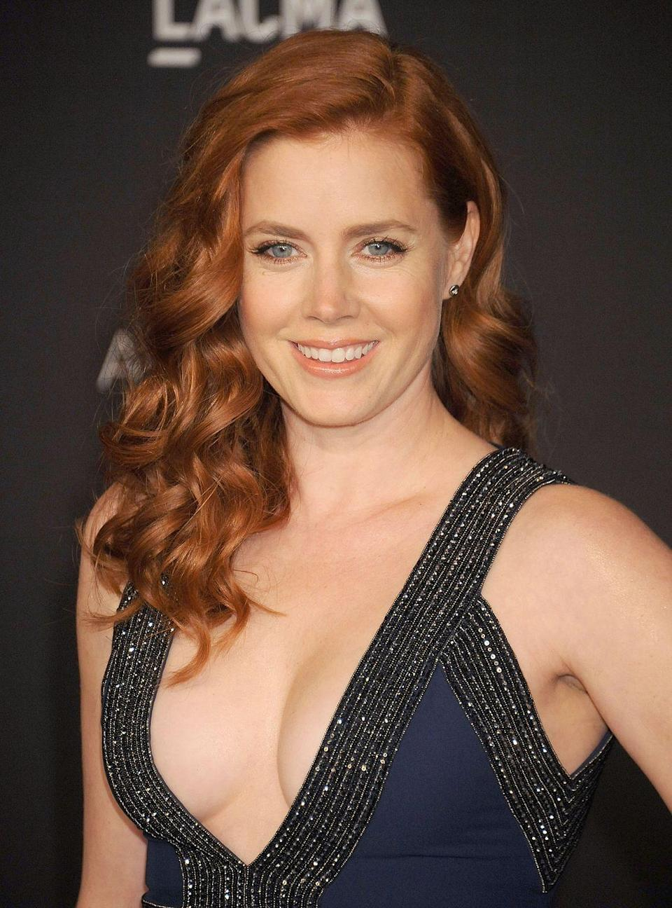 """<p>Before she was being nominated for awards, Amy Adams was one of the many celebrities who got their start as Hooters girls. """"It was a great job out of high school,"""" she told <em>Entertainment Tonight</em>, <em><a href=""""https://www.dailymail.co.uk/tvshowbiz/article-2907062/Amy-Adams-reveals-used-curves-Hooters-waitress.html"""" rel=""""nofollow noopener"""" target=""""_blank"""" data-ylk=""""slk:The Daily Mail"""" class=""""link rapid-noclick-resp"""">The Daily Mail</a></em> reports. """"I was a hostess at first and then I waited tables for a while and it was a great way to earn money for a car.""""</p>"""