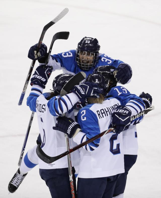 Ice Hockey - Pyeongchang 2018 Winter Olympics - Women's Quarterfinal Match - Finland v Sweden - Kwandong Hockey Centre, Gangneung, South Korea - February 17, 2018 - Team Finland celebrates after teammate Riikka Valila (13) scored against Sweden. REUTERS/David W Cerny