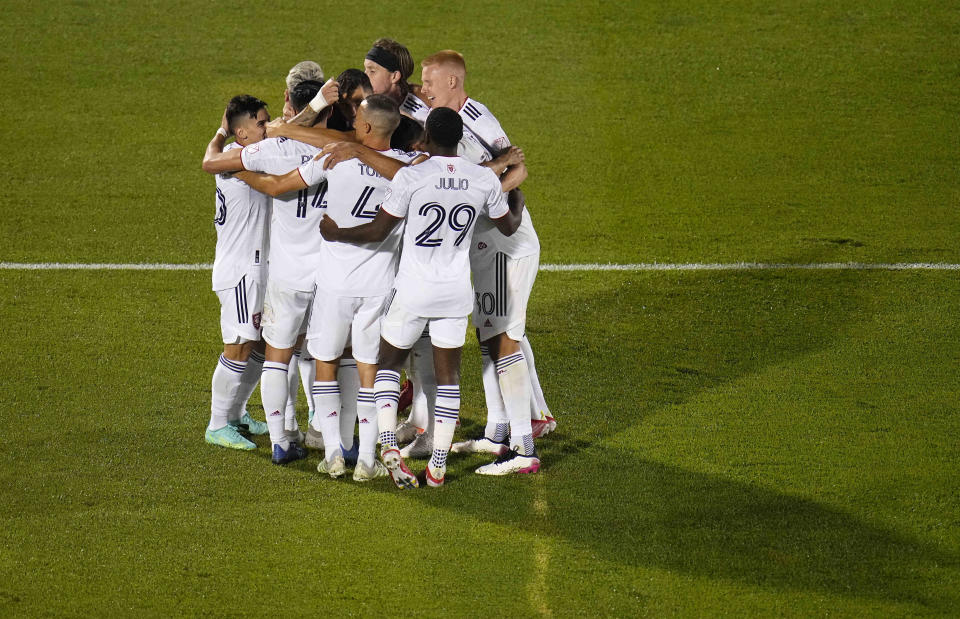 Teammates congratulate Real Salt Lake midfielder Albert Rusnak (11) after his goal against the Colorado Rapids during the second half of an MLS soccer match Saturday, Aug. 21, 2021, in Commerce City, Colo. (AP Photo/ Jack Dempsey)