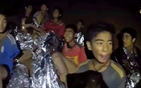 The Thai boys have appeared to be in good spirits in videos from the cave - Credit: HOGP/AP