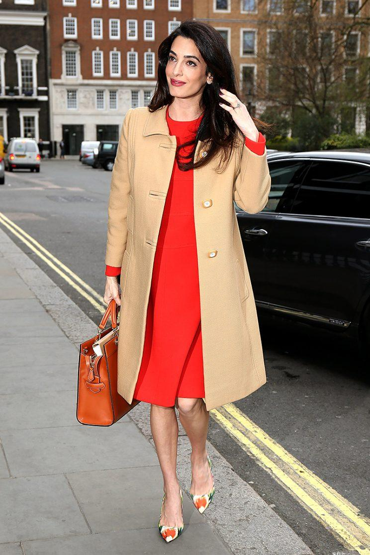 Pregnant Amal Clooney Rings In Spring With Scarlet Dress