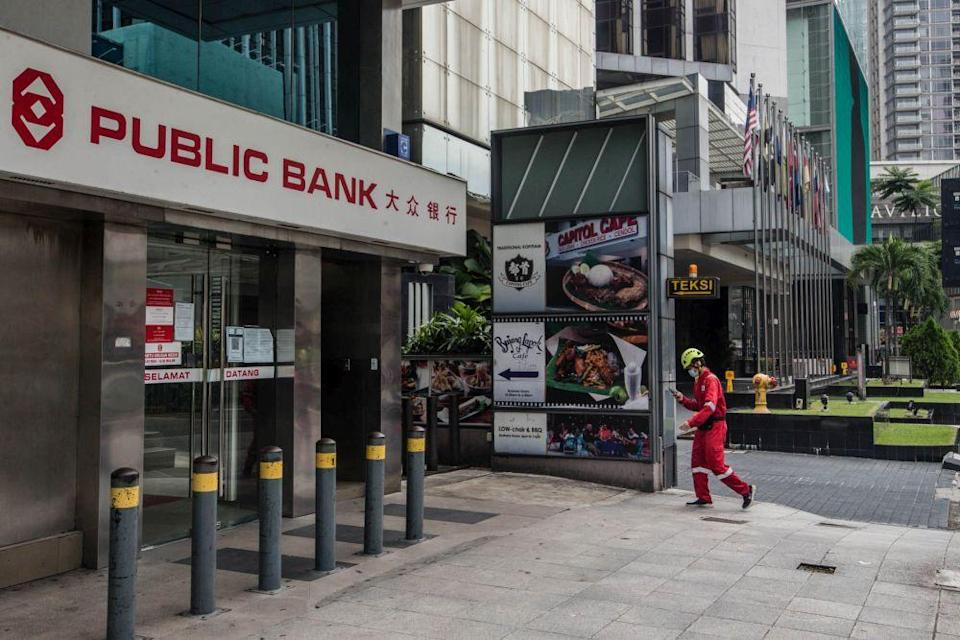 Public Bank allows credit card users to apply to make a one-time conversion of their outstanding balance to a term loan of up to 36 months at a 13 per cent per annum. — Picture by Firdaus Latif