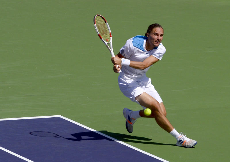 Alexandr Dolgopolov, of Ukraine, returns a shot to Roger Federer, of Switzerland, during their semifinal match at the BNP Paribas Open tennis tournament, Saturday, March 15, 2014, in Indian Wells, Calif. (AP Photo/Mark J. Terrill)