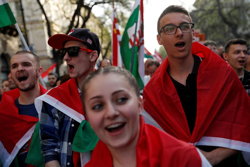 People march in protest against Prime Minister Orbán in Budapest on April 14. (Bernadett Szabo / Reuters)
