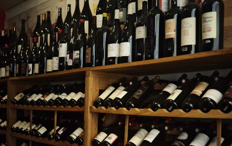 Wine bottle are seen in a wine shop in Paris, Thursday, Oct. 3, 2019. The European Union will retaliate against the U.S. decision to slap tariffs on a range of the bloc's exports - from cheese to wine - that are expected to cause job losses, governments and industry groups said Thursday. (AP Photo/Kamil Zihnioglu)