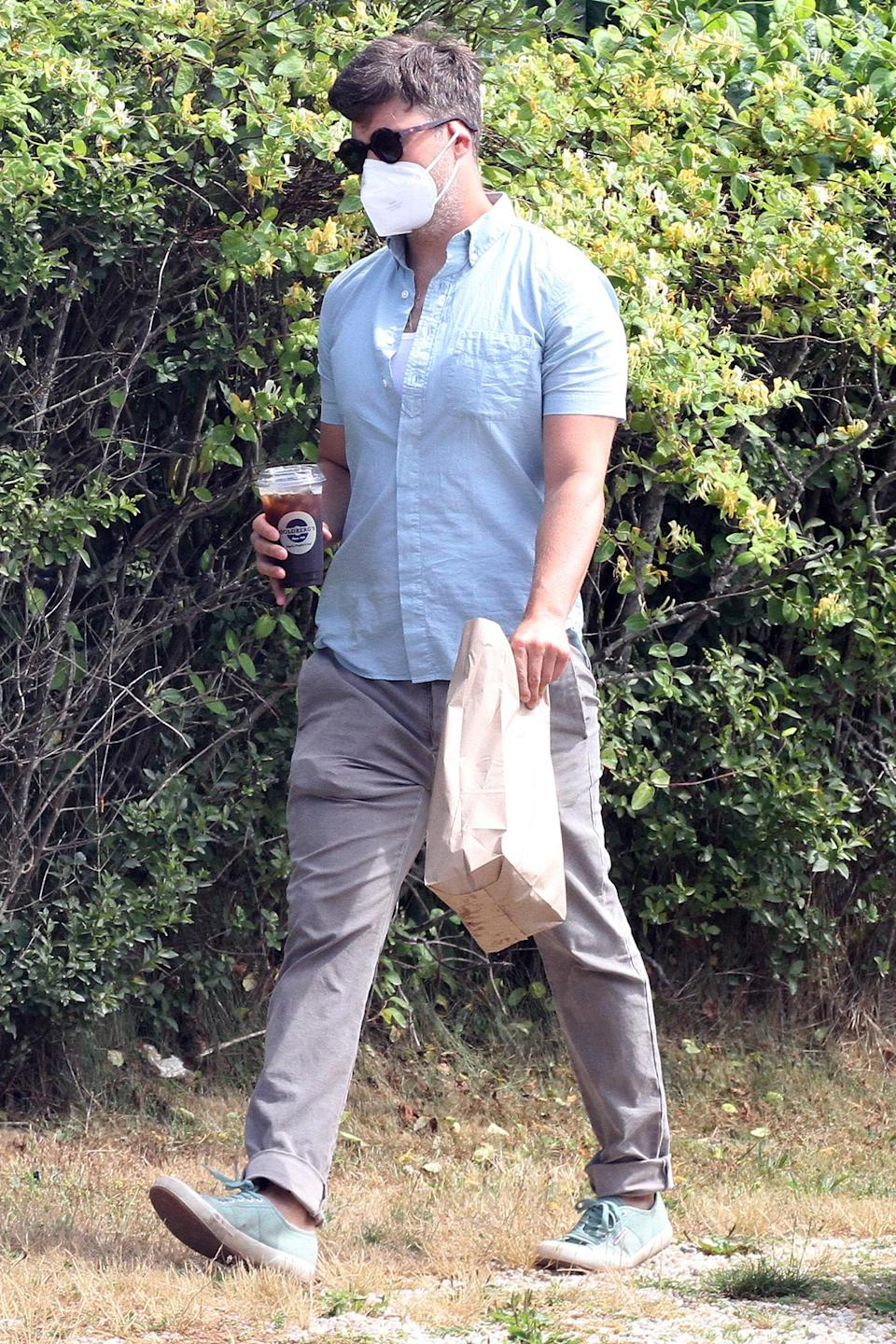 <p>Colin Jost makes a bagel run in The Hamptons, New York, on Monday, his 38th birthday.</p>